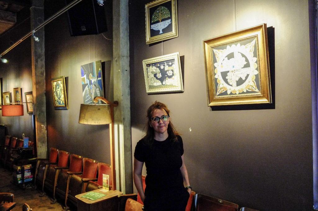 Silvia Karamfilova in gallery with paintings